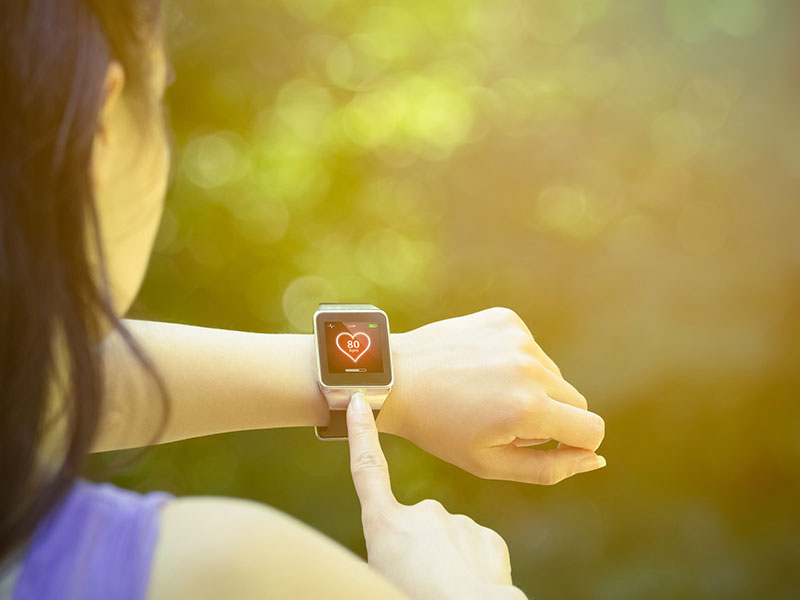 Woman checking heart rate on watch