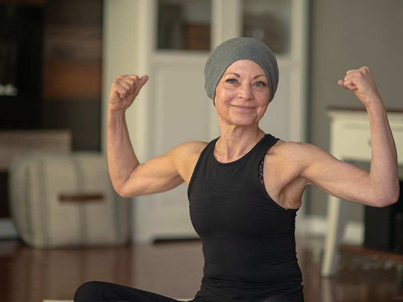 Woman flexing her arms